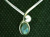 925 SILVER TORK STYLE NECKLACE FEATURING A LARGE OVAL CABOCHON IN LABRADORITE. ND2181