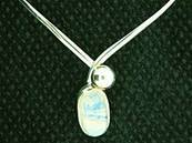 925 SILVER TORK STYLE NECKLACE FEATURING A LARGE OVAL CABOCHON IN MOONSTONE. NL2181