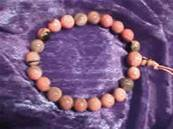 RHODONITE POWER BEAD BRACELET (ELASTICATED).   270