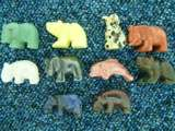 SETS OF CARVED ANIMALS