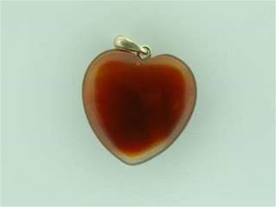 CARNELION HEART SHAPED PENDANT COMPLETE WITH SILVER BAIL. 32MM DROP INC BAIL X 25MM WIDE. 8g.