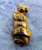 CARVING FEATURING OTTER ON IT'S BACK IN TIGERSEYE. SP9094POL