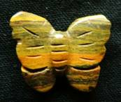 BUTTERFLY CARVING IN TIGERS IRON. SPR3971POL