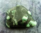 EMERALD IN PHLOGOPITE MATRIX HAND POLISHED PEBBLE. SP6488POL