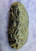 TEKTITE WITH CARVING CARVED RELIEF ON ONE SIDE. SP9173POL